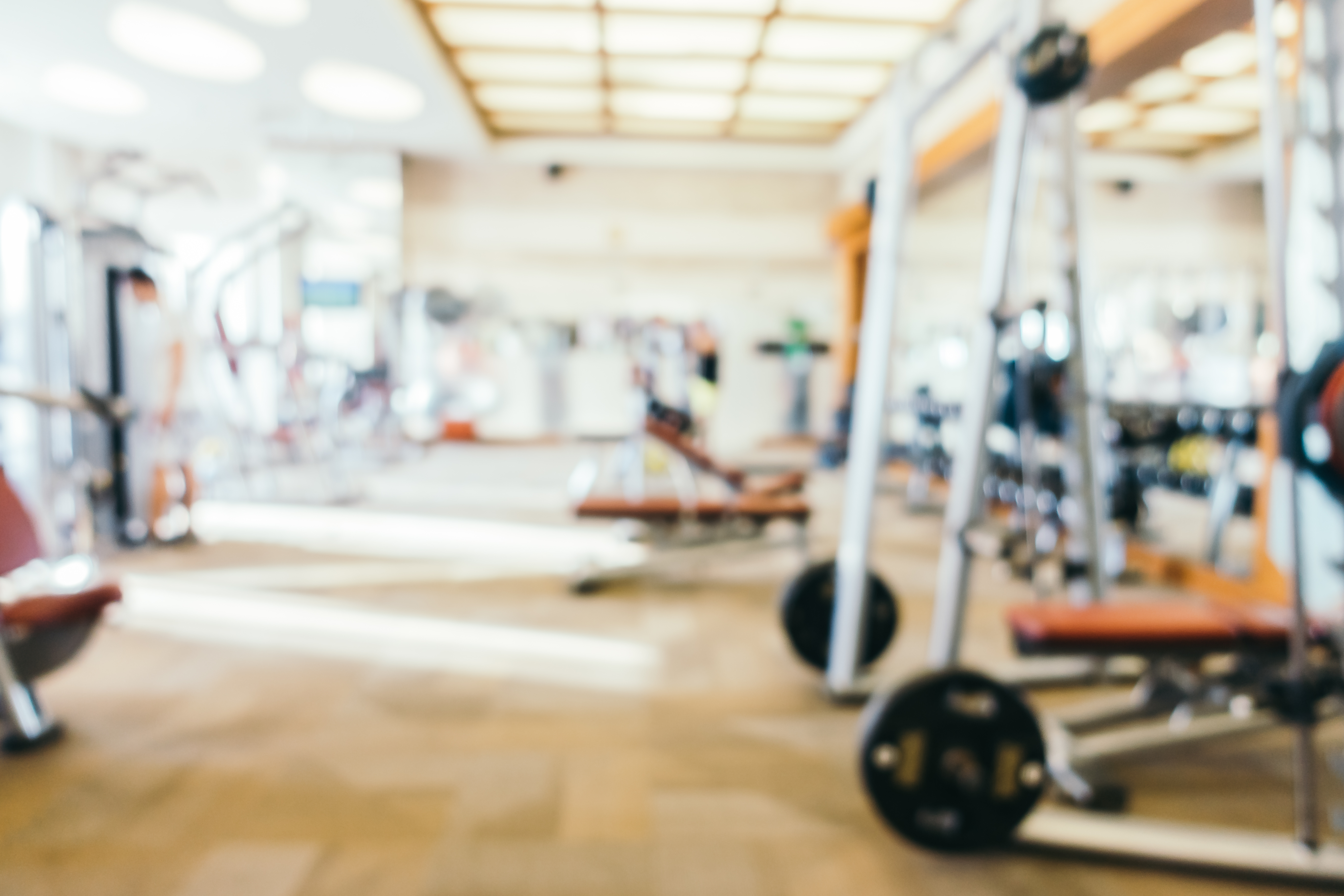Abstract blur fitness and gym room interior for background